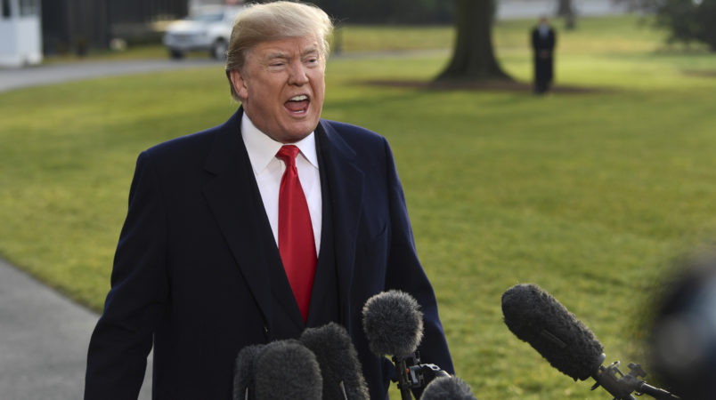 "President Donald Trump speaks to reporters before boarding Marine One on the South Lawn of the White House in Washington, Monday, Dec. 4, 2017, before heading to Utah. Trump is announcing plans to scale back two sprawling national monuments in Utah, responding to what he has condemned as a ""massive federal land grab"" by the government. (AP Photo/Susan Walsh)"