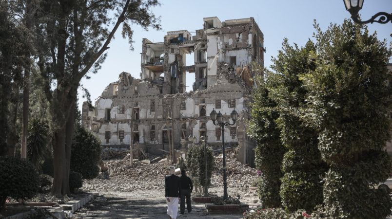 Houthi Shiite rebels inspect the rubble of the Republican Palace destroyed by Saudi-led airstrikes in Sanaa, Yemen, Wednesday, Dec. 06, 2017. (AP Photo/Hani Mohammed)