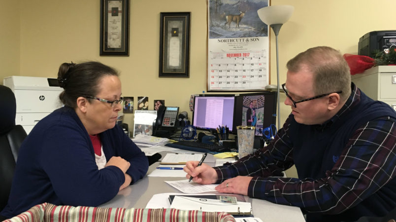 /// CAPTIONDavid Ermold files to run for Rowan County Clerk in Kentucky as Clerk Kim Davis look on in Morehead, Kentucky, on Wednesday, Dec. 6, 2017. Davis denied Ermold and his husband a marriage license two years ago because she was opposed to gay marriage for religious reasons.Photo taken by Adam Beam