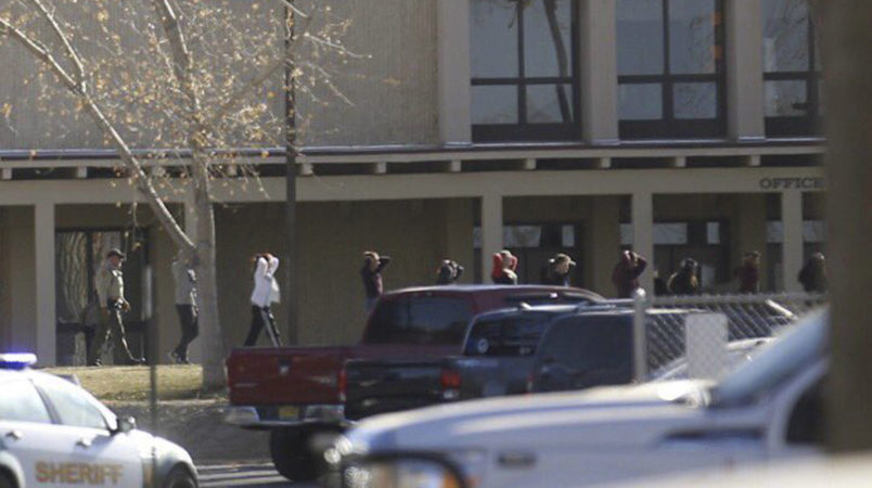 Students are led out of Aztec High School after a shooting Thursday, Dec. 7, 2017, in Aztec, N.M. Authorities say three people dead. The school is in the Four Corners region and is near the Navajo Nation.(Jon Austria/The Daily Times via AP)