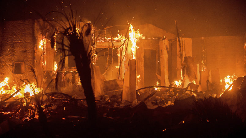 Flames consume a structure as the Lilac fire burns in Bonsai, Calif., on Friday, Dec. 8, 2017. The blaze burned at least five structures and 4,100 acres according to fire officials. Wind-swept blazes have forced tens of thousands of evacuations and destroyed dozens of homes in Southern California. (AP Photo/Noah Berger)