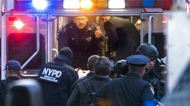 NYPD and FDNY officials place suspect  Akayed Ullah, on a stretcher, into the back of an ambulance on 8th Ave. between 42nd and 43rd Streets, Monday, Dec. 11, 2017 in New York. Ullah set off a crude pipe bomb strapped to his body in a crowded subway corridor near Times Square, injuring the man, slightly wounding three others and sending New York commuters fleeing in terror through the smoky passageway. (Craig Ruttle/Newsday via AP)