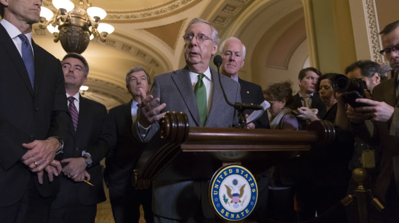 Senate Majority Leader Mitch McConnell, R-Ky., center, joined by, from left, Sen. John Thune, R-S.D., Sen. Cory Gardner, R-Colo., Sen. Roy Blunt, R-Mo., and Majority Whip John Cornyn, R-Texas, speaks to reporters about the GOP tax bill following a closed-door strategy session on Capitol Hill in Washington, Tuesday, Dec. 12, 2017.  (AP Photo/J. Scott Applewhite)