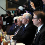 Vice President Mike Pence, flanked by Rep. Peter Roskam, R-Ill., right, and Sen. Mike Enzi, R-Wyo., third from right, listens to President Donald Trump speak during a bicameral meeting with lawmakers working on the tax cuts in the Cabinet Meeting Room of the White House in Washington, Wednesday, Dec. 13, 2017. (AP Photo/Manuel Balce Ceneta)