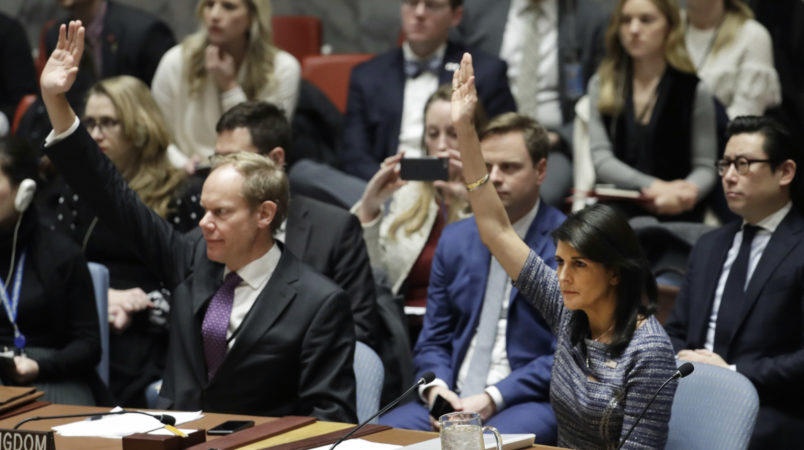 Matthew Rycroft, left, Britain's ambassador to the U.N. and U.S. Ambassador Nikki Haley vote in favor of a resolution, Friday, Dec. 22, 2017, at United Nations headquarters. The council is voting on proposed new sanctions against North Korea, including sharply lower limits on its refined oil imports, the return home of all North Koreans working overseas within 12 months, and a crackdown on the country's shipping. (AP Photo/Mark Lennihan)