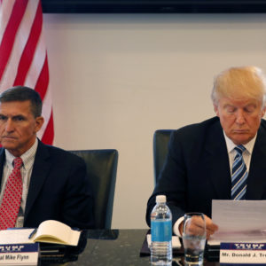 Republican presidential candidate Donald Trump, conducts a roundtable discussion on national security in his offices in Trump Tower in New York, Wednesday, Aug. 17, 2016. Left is Ret. Army Gen. Mike Flynn and right is Ret. Army Lt. Gen. Keith Kellogg. (AP Photo/Gerald Herbert)