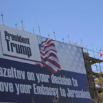 A sign hangs on a building under construction in Jerusalem congratulating U.S. President Donald Trump, Friday, Jan. 20, 2017. Trump has vowed to move the U.S. embassy from Tel Aviv to more controversial Jerusalem. (AP Photo/Ariel Schalit)