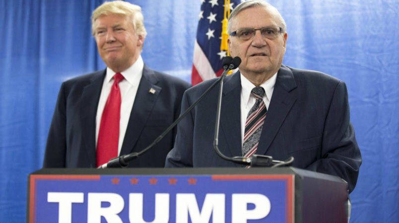 FILE - In this Jan. 26, 2016, file photo, then-Republican presidential candidate Donald Trump is joined by Joe Arpaio, the then sheriff of metro Phoenix, during a news conference in Marshalltown, Iowa. The former Phoenix-area sheriff who was pardoned by President Donald Trump from his federal contempt-of-court conviction in an immigration case is experiencing a wobbly return to the public speaking circuit.In Las Vegas, security concerns prompted event planners to move Arpaio's scheduled weekend appearance to an undisclosed location away from the casino-lined Strip tourist district. (AP Photo/Mary Altaffer, File)