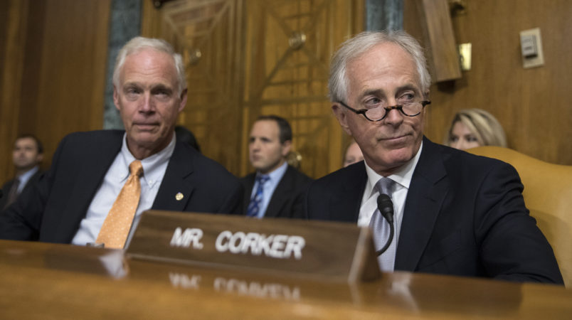 Senate Budget Committee members Sen. Bob Corker, R-Tenn., right, and Sen. Ron Johnson, R-Wis., left  attend a Senate Budget Committee hearing to consider fiscal year 2018 reconciliation legislation on Capitol Hill in Washington, Tuesday, Nov. 28, 2017. The Senate Budget Committee has advanced a sweeping tax package to the full Senate, handing GOP leaders a victory as they try to pass the nation's first tax overhaul in 31 years. (AP Photo/Carolyn Kaster)