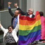Members of parliament Cathy McGowan, Adam Brandt and Andrew Wilkie celebrate the passing of the Marriage Amendment Bill in the House of Representatives at Parliament House in Canberra, Thursday, Dec. 7, 2017. Gay marriage was endorsed by 62 percent of Australian voters who responded to a government-commissioned postal ballot by last month. (Mick Tsikas/AAP Image via AP)