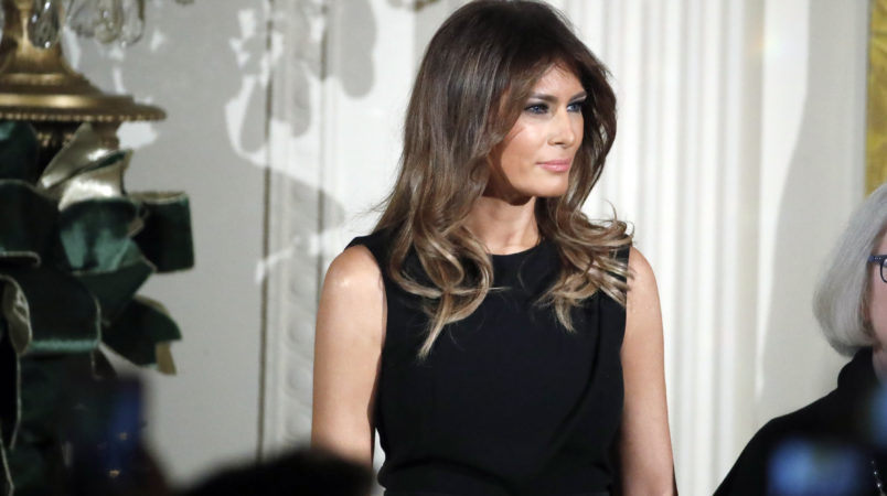 First Lady surfaces and Trump jokes,