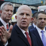 New York City Police Commissioner James O'Neill holds a news conference outside the Port Authority Bus Terminal with Mayor Bill de Blasio, left, and Gov. Andrew Cuomo, Monday, Dec. 11, 2017, in New York. A pipe bomb strapped to a man went off in the New York City subway near Times Square on Monday, injuring the suspect and another person at the height of the morning rush hour, law enforcement officials said. (AP Photo/Mark Lennihan)