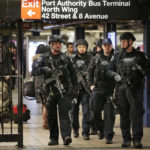 Heavily armed police officers patrol near the site of a terror attack in the subways under Port Authority Bus Terminal in New York, Tuesday, Dec. 12, 2017. A would-be suicide bomber's rush-hour blast in the heart of the New York City subway system failed to cause the bloodshed he intended, authorities said, but it gave new fuel to President Donald Trump's push to limit immigration. (AP Photo/Seth Wenig)