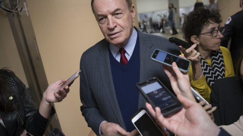 Reporters seek a comment from Sen. Richard C. Shelby, R-Ala., a critic of Alabama Republican Roy Moore who is running for the Senate in a special election, on Capitol Hill in Washington, Tuesday, Dec. 12, 2017.  (AP Photo/J. Scott Applewhite)