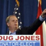 Democrat speaks Doug Jones speaks during a news conference Wednesday, Dec. 13, 2017, in Birmingham, Ala.  (AP Photo/John Bazemore)
