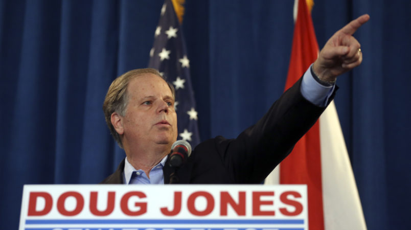 Democrat speaks Doug Jones speaks during a news conference Wednesday, Dec. 13, 2017, in Birmingham, Ala.  (AP Photo/John Bazemore)