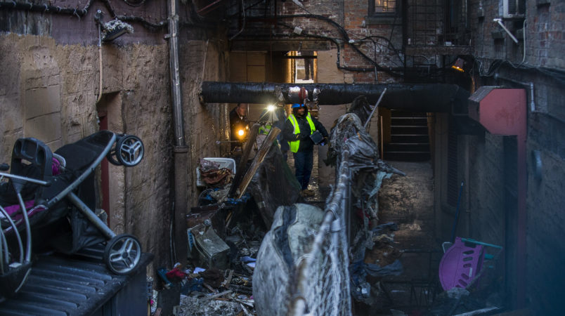 Police and workers inspect the building where twelve people died in a fire on Thursday, on Friday, Dec. 29, 2017, in the Bronx borough of New York.  (AP Photo/Andres Kudacki)