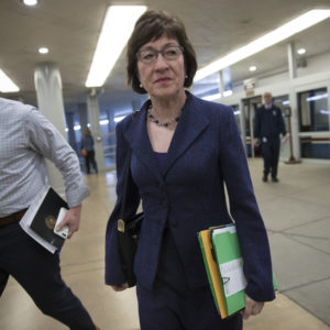 Sen. Susan Collins, R-Maine, arrives for a caucus meeting as the Republican majority in Congress prepares to vote on the biggest reshaping of the U.S. tax code in three decades, on Capitol Hill, in Washington, Tuesday, Dec. 19, 2017. (AP Photo/J. Scott Applewhite)