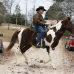 U.S. Senate candidate Roy Moore rides a horse to vote during the Alabama senatorial election, Tuesday, Dec. 12, 2017, in Gallant, Ala. (AP Photo/Brynn Anderson)