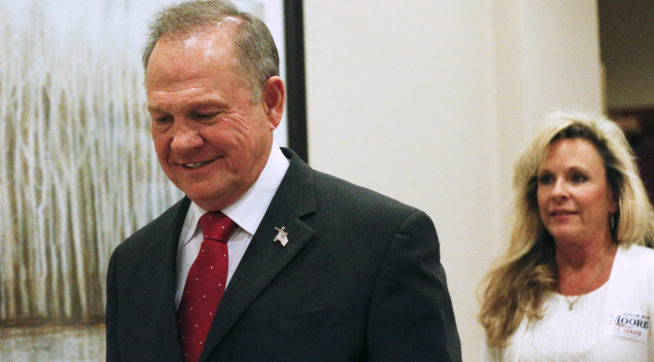 Former Alabama Chief Justice and U.S. Senate candidate Roy Moore walks in to speak at a press conference Thursday Nov. 16 2017 in Birmingham Ala