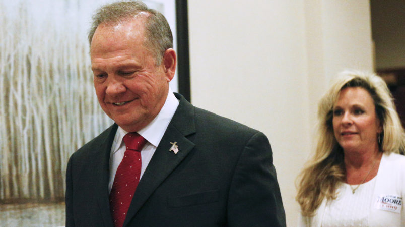 Former Alabama Chief Justice and U.S. Senate candidate Roy Moore walks in to speak at a press conference, Thursday, Nov. 16, 2017, in Birmingham, Ala. (AP Photo/Brynn Anderson)