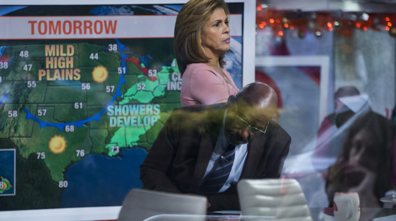"Anchor Hoda Kotb, with co-anchor Al Roker, lower center, stands on the set of the Today Show between segments Wednesday, Nov. 29, 2017, in New York, in the wake of the firing of 'Today' co-anchor Matt Lauer. NBC News fired the longtime host on Wednesday for ""inappropriate sexual behavior,"" making him the second morning television show personality to lose his job because of sexual misconduct charges in a week. (AP Photo/Craig Ruttle)"