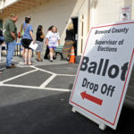 Voters wait in line at the Supervisor of Elections office in Lauderhill to drop off their absentee ballots, Monday, November 5, 2012, in Ft. Lauderdale, Florida. (Susan Stocker/Sun Sentinel/MCT)