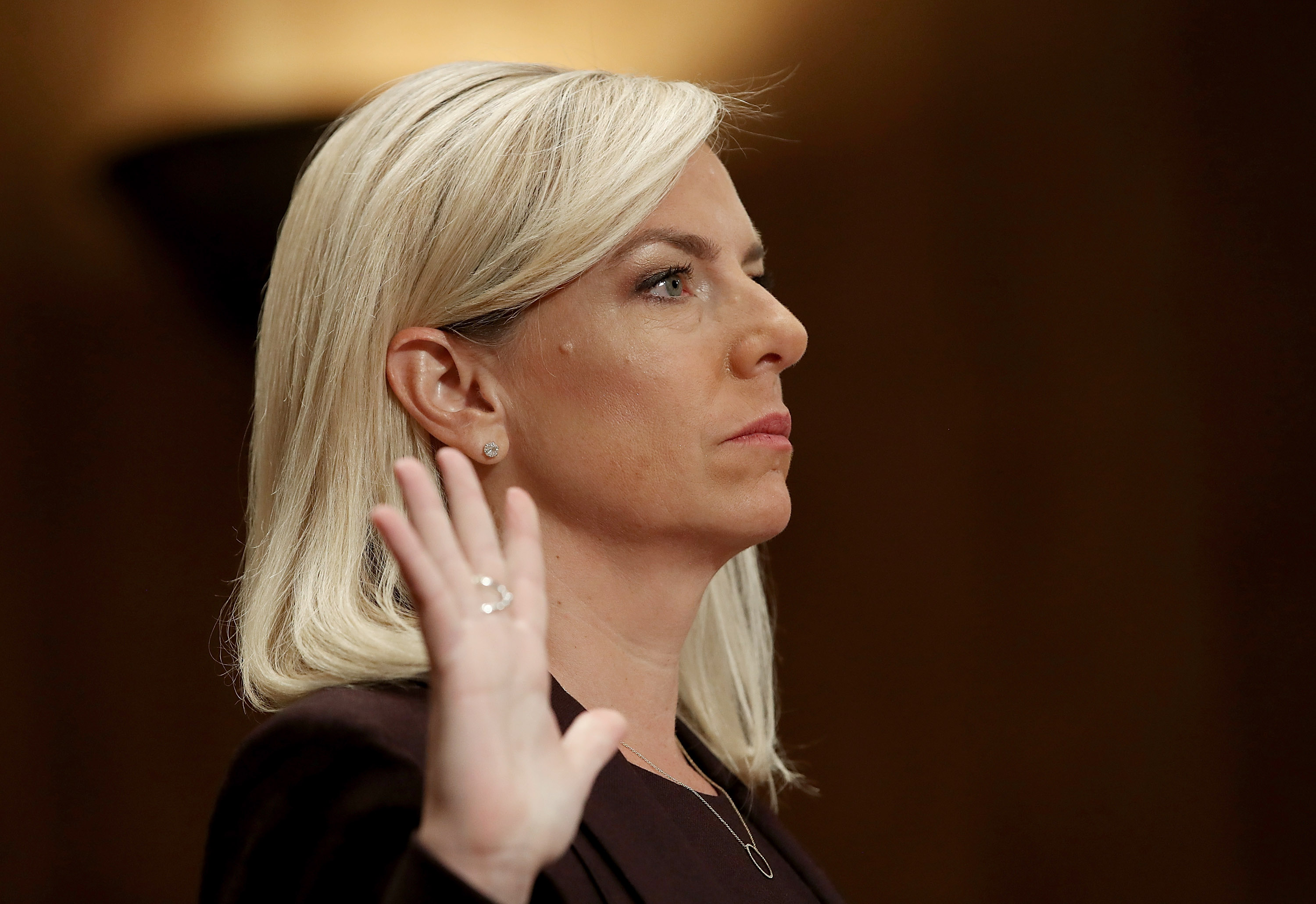 WASHINGTON, DC - NOVEMBER 08:  Kirstjen Nielsen, nominee to be the next Secretary of the Homeland Security Department, is sworn in before the Senate Homeland Security and Governmental Affairs Committee November 8, 2017 in Washington, DC. Nielsen, if confirmed, will fill the cabinet role formerly held by Gen. John Kelly, current White House Chief of Staff. (Photo by Win McNamee/Getty Images)