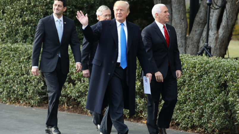 U.S. President Donald Trump, flanked by Republican lawmakers, celebrates Congress passing the Tax Cuts and Jobs Act with Republican members of the House and Senate on the South Lawn of the White House on December 20, 2017 in Washington, DC. The tax bill is the first major legislative victory for the GOP-controlled Congress and Trump since he took office almost one year ago.