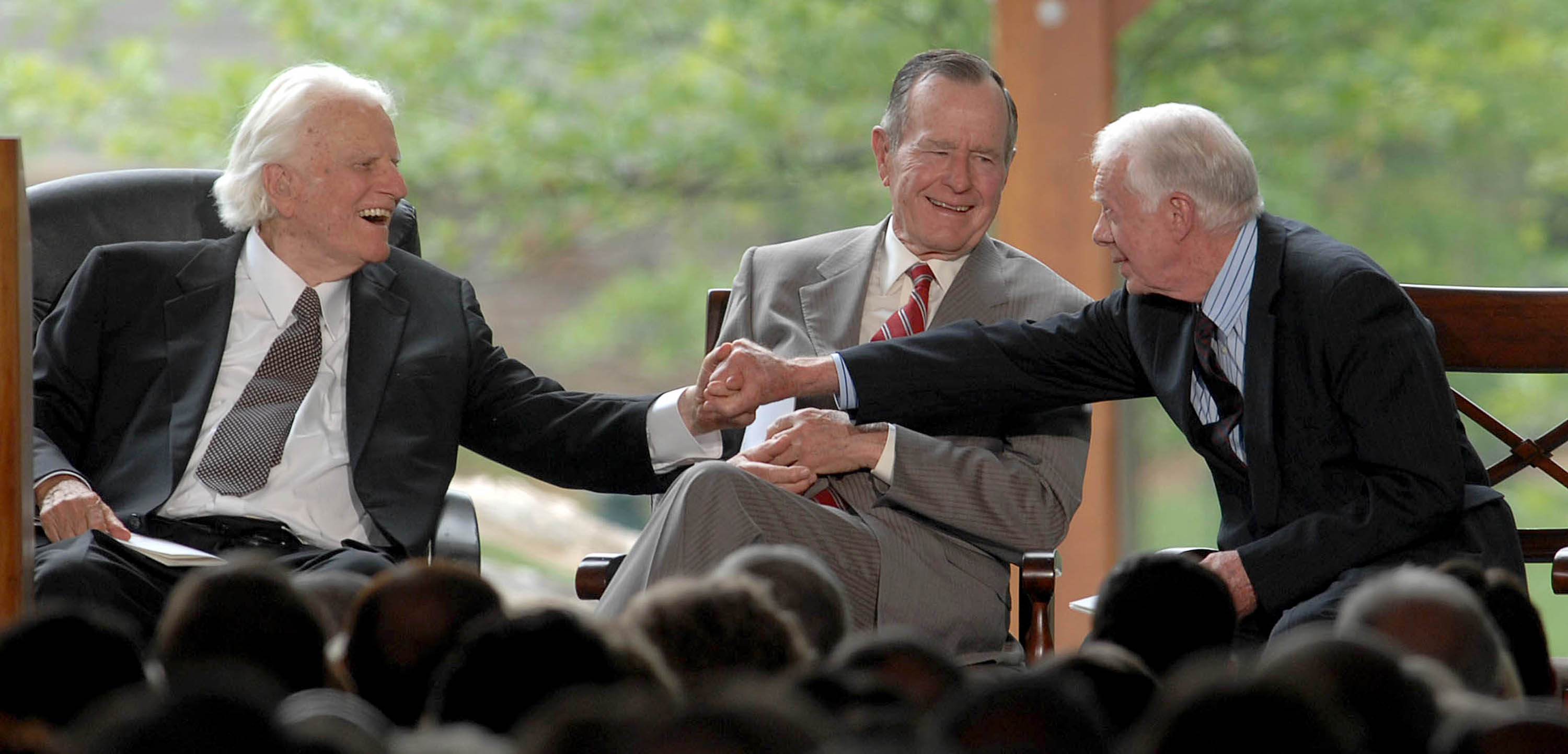 Billy Graham shakes hands with Billy Carter at the dedication ceremony for the Billy Graham Library in Charlotte, North Carolina, Thursday, May 31, 2007. (Todd Sumlin/Charlotte Observer/MCT)