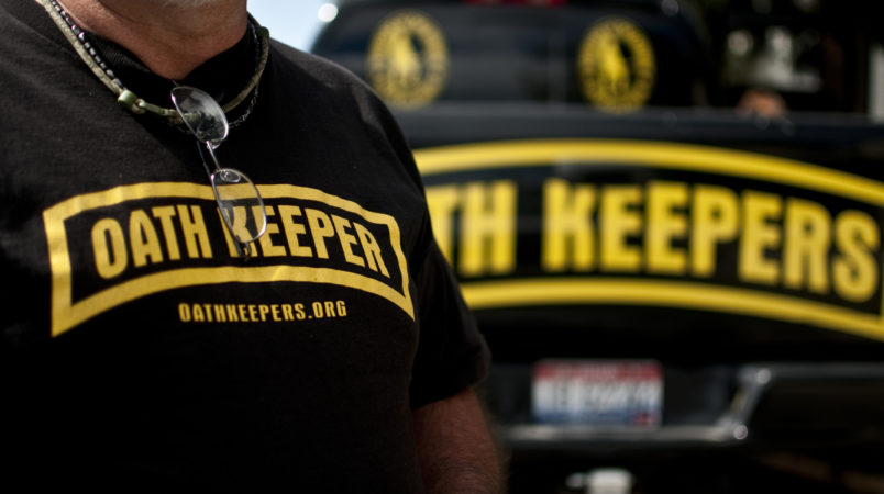 "An Oath Keeper from Idaho in Bozeman, Montana. The ""Oath Keepers"" are a national, ultra-rightwing ""Patriot"" group comprised of former and active military, police and public safety personnel who have taken an oath to ""uphold the Constitution"" and to refuse to follow orders that they decide are unconstitutional."