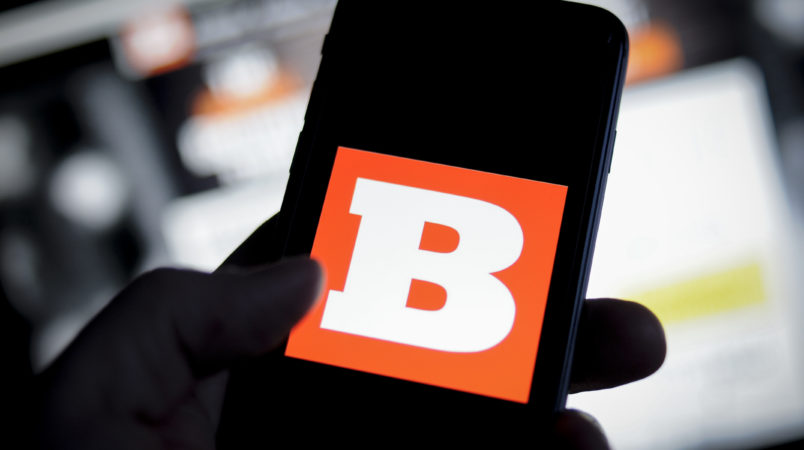 The Breitbart logo is seen on an iPhone with the Breitbart website in the background in this photo illustration on November 20, 2017. (Photo by Jaap Arriens/NurPhoto)