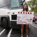 A Stoneman Douglas student waits to board buses to Tallahassee, Fla., heading to the Florida Capitol to advocate for gun control on Tuesday, February 20, 2018. (Emily Michot/Miami Herald/TNS)
