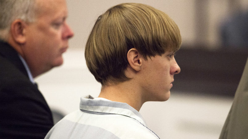 Dylann Roof (R), the 21-year-old man charged with murdering nine worshippers at a historic black church in Charleston last month, listens to the proceedings with assistant defense attorney William Maguire during a hearing at the Judicial Center in Charleston, South Carolina July 16, 2015.   REUTERS/Randall Hill