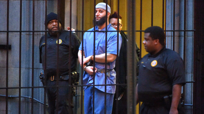 """Officials escort """"Serial"""" podcast subject Adnan Syed from the courthouse following the completion of the first day of hearings for a retrial in Baltimore on Wednesday, Feb. 3, 2016. (Karl Merton Ferron/Baltimore Sun/TNS)"""