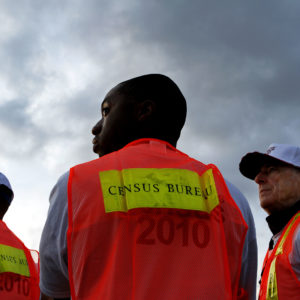 Baylen, Liz –– – LOS ANGELES, CA – MARCH 30, 2010 (Middle) Shamar Drew, 30, of LA, and (right) David Brown, 67, of LA, say working as enumerators for the Census is something fun to do and it also allows them to make a little extra money. They are among many Census workers, who picked up materials at Dodger Stadium before heading out to count the number of homeless people, March 30, 2010, in Los Angeles. ( Liz O. Baylen / Los Angeles Times )