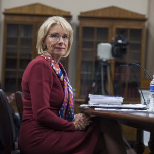 UNITED STATES - MARCH 20: Education Secretary Betsy DeVos prepares to testify at a House Appropriations Labor, Health and Human Services, Education and Related Agencies Subcommittee hearing in Rayburn Building on the department's FY2019 budget on March 20, 2018. (Photo By Tom Williams/CQ Roll Call)