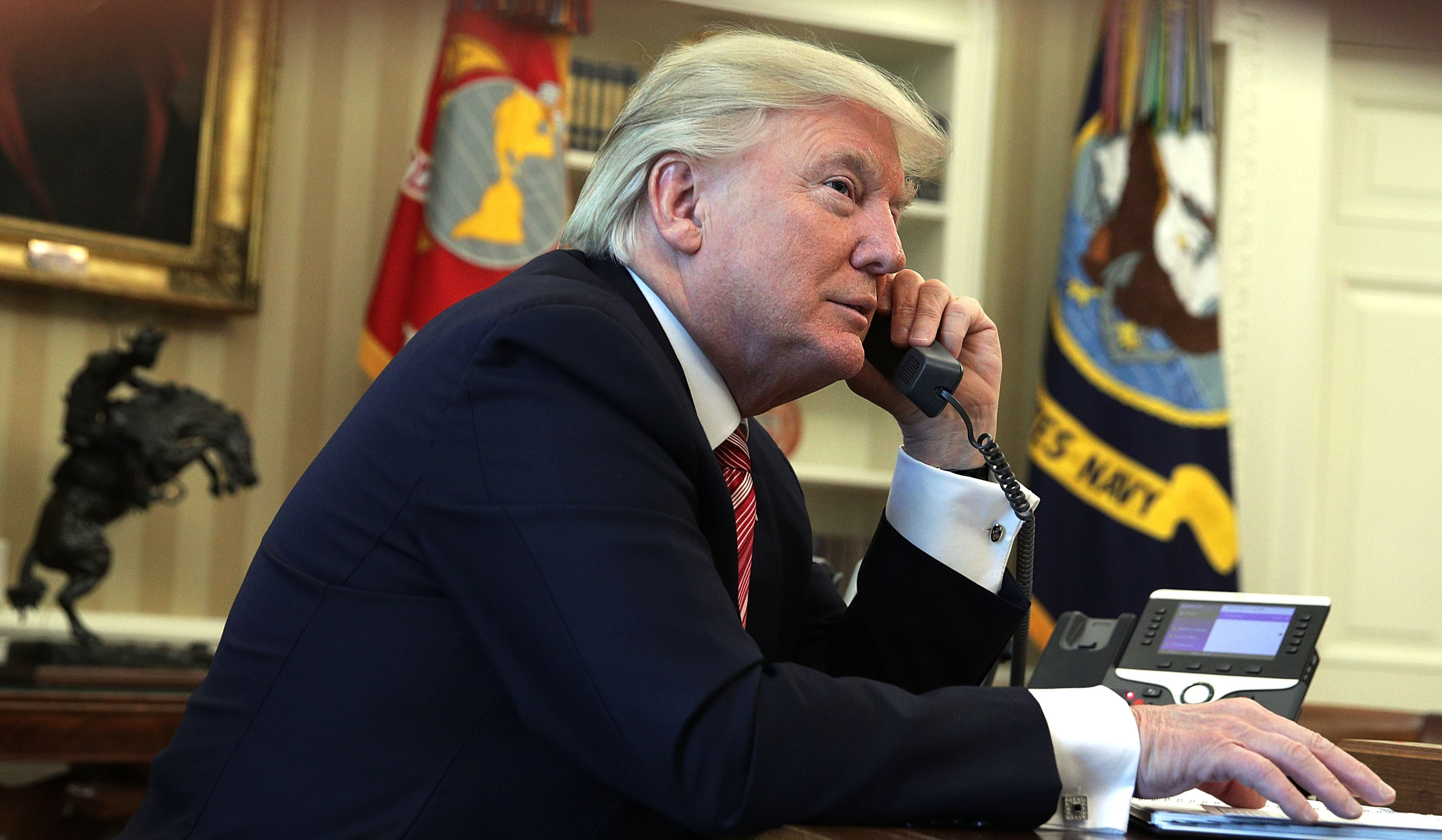 WASHINGTON, DC - JUNE 27:  U.S. President Donald Trump speaks on the phone with Irish Prime Minister Leo Varadkar on the phone in the Oval Office of the White House June 27, 2017 in Washington, DC. President Trump congratulated Prime Minister Varadkar to become the new leader of Ireland.  (Photo by Alex Wong/Getty Images)