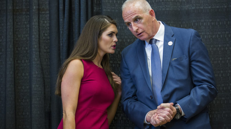 DERRY, NH  - AUGUST 19:   Hope Hicks is Republican Presidential candidate Donald Trump's campaign spokeswoman,  speaks with with head of security Keith Schiller, at a campaign event,  August 19, 2015 in Derry, NH.  (Photo by Brooks Kraft/ Getty Images)