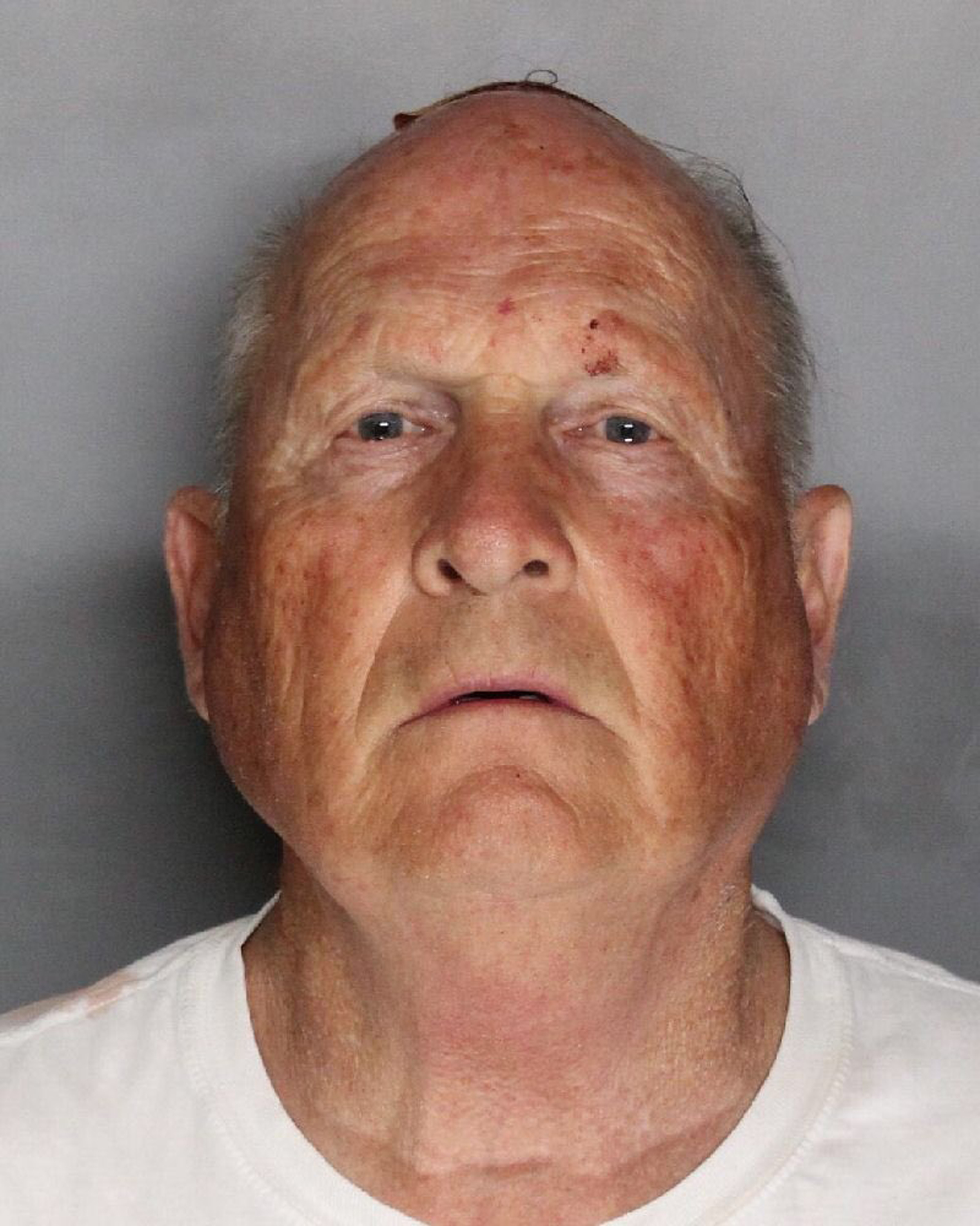 This undated law enforcement booking photo provided by the Sacramento County, Calif., Sheriff's Office shows Joseph James DeAngelo. California authorities said Wednesday, April 25, 2018 that DeAngelo is the man they suspect of being a serial killer tied to dozens of slayings and sexual assaults in the 1970s and '80s, and has been charged with murder. (Sacramento County Sheriff's Office via AP)