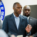 FILE - In this June 5, 2017, file photo, Arizona state Democratic Rep. Reginald Bolding Jr., left, calls on Gov. Doug Ducey to remove six confederate monuments in Arizona during a news conference by the NAACP and Black Lives Matter in Phoenix, Ariz. Bolden successfully pushed for changes in the state's driving rules that inform gun-carrying motorists how they should handle themselves if they get pulled over by police officers. (AP Photo/Angie Wang, File)