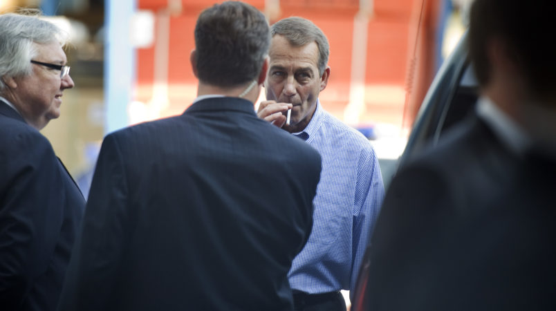 """UNITED STATES - SEPTEMBER 23:  House Minority Leader John Boehner, R-Ohio, smokes a cigarette after a news conference outside of Tart Lumber Company in Sterling, Va., were they unveiled """"A Pledge to America,"""" a governing agenda devised by House Republicans for the 111th Congress.  (Photo By Tom Williams/Roll Call via Getty Images)"""