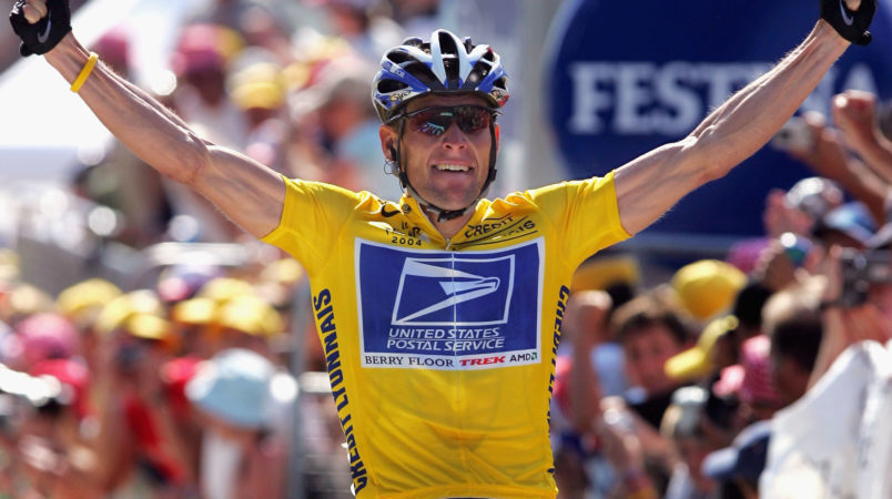 LE GRAND BORNAND, FRANCE - JULY 22:  Lance Armstrong of the USA and riding for US Postal Service presented by Berry Floor celebrates as he wins stage 17 of the Tour de France on July 22, 2004 from Bourg d'Oisans to le Grand Bornand, France. (Photo by Doug Pensinger/Getty Images) *** Local Caption *** Lance Armstrong