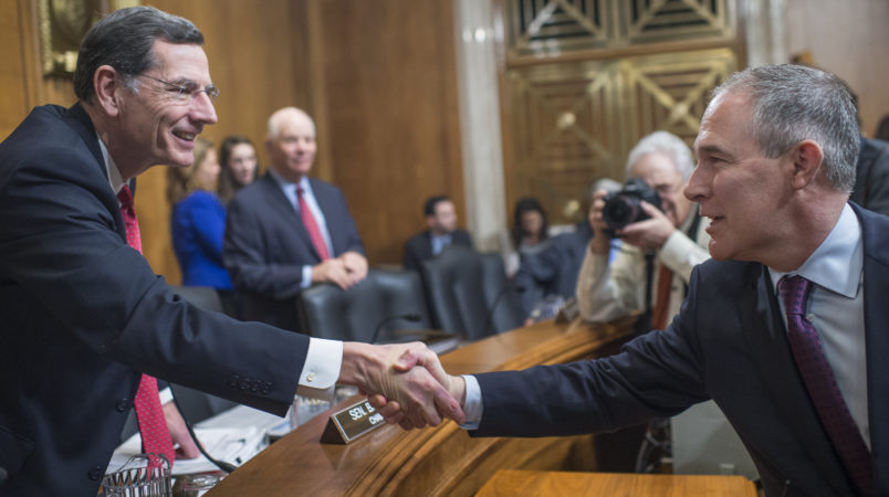 UNITED STATES - JANUARY 18: Chairman John Barrasso, R-Wyo., left, greets Scott Pruitt, President-elect Trump's nominee to be administrator of the Environmental Protection Agency, before his Senate Environment and Public Works Committee confirmation hearing in Dirksen Building, January 18, 2017. (Photo By Tom Williams/CQ Roll Call)