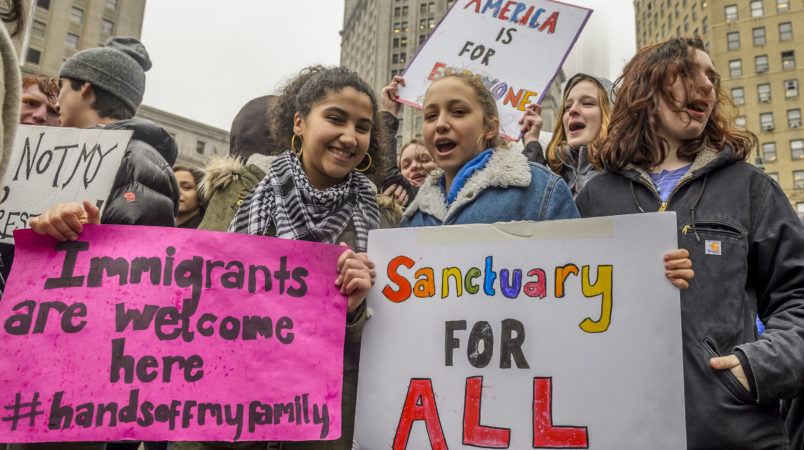 """FOLEY SQUARE, NEW YORK, NY, UNITED STATES - 2017/02/07: High School and College students from across New York City walked out of classes at noon and congregated at Foley Square, united in opposition to the recent illegal executive order targeting Muslims and refugees, also known as the """"Muslim Ban."""". (Photo by Erik Mcgregor/Pacific Press/LightRocket via Getty Images)"""