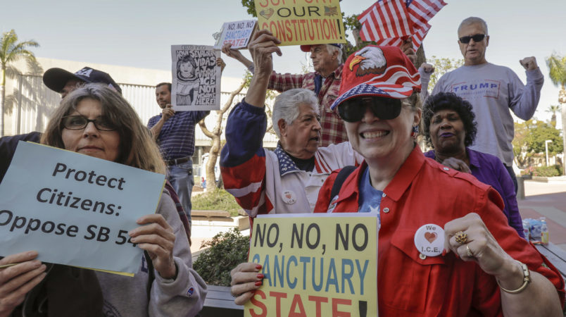 SANTA ANA CA MARCH 27, 2018 --- People opposing SB-54 celebrate. The Orange County Board of Supervisors approved a resolution to condemn the state's sanctuary laws. They also voted to join the Feds in their lawsuit against State of California. (Irfan Khan / Los Angeles Times)