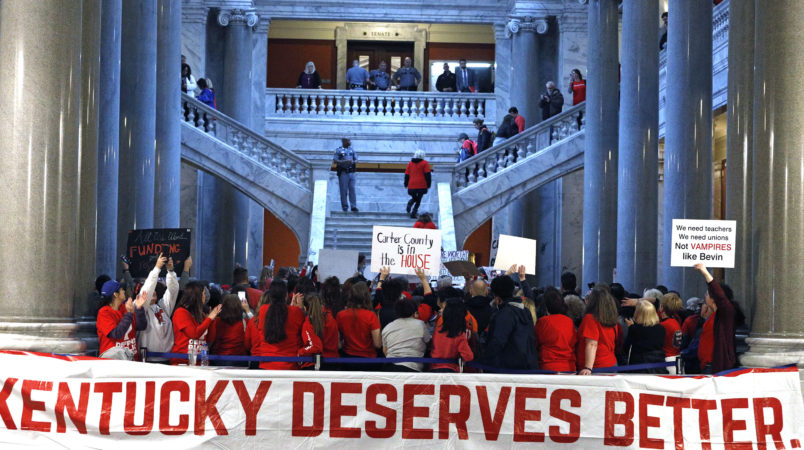 FRANKFORT, KY-APRIL 2: Public school teachers and their supporters protest against a pension reform bill outside the senate chambers at the Kentucky State Capital April 2, 2018 in Frankfort, Kentucky. The teachers are calling for higher wages and are demanding that Kentucky Gov. Matt Bevin veto a bill that overhauls their pension plan. (Bill Pugliano/Getty Images)