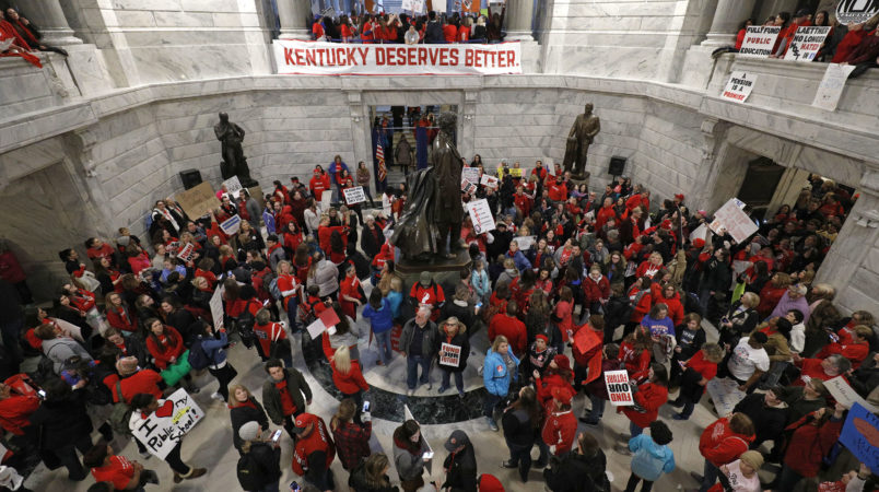 FRANKFORT, KY-APRIL 2: Public school teachers and their supporters protest against a pension reform bill in the rotunda of the Kentucky State Capital April 2, 2018 in Frankfort, Kentucky. The teachers are calling for higher wages and are demanding that Kentucky Gov. Matt Bevin veto a bill that overhauls their pension plan. (Bill Pugliano/Getty Images)