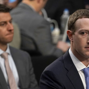 WASHINGTON, DC - APRIL 10:  Facebook co-founder, Chairman and CEO Mark Zuckerberg testifies before a combined Senate Judiciary and Commerce committee hearing in the Hart Senate Office Building on Capitol Hill April 10, 2018 in Washington, DC. Zuckerberg, 33, was called to testify after it was reported that 87 million Facebook users had their personal information harvested by Cambridge Analytica, a British political consulting firm linked to the Trump campaign.  (Photo by Alex Wong/Getty Images)
