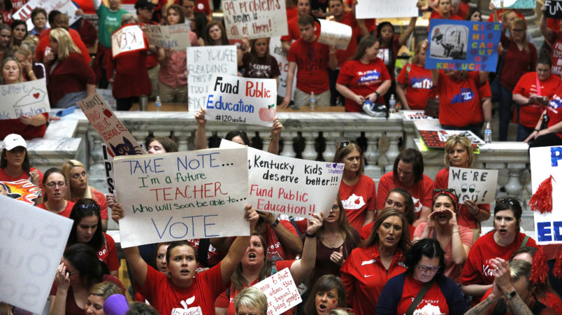 "FRANKFORT, KY-APRIL 13: Kentucky Public school teachers protest outside the Kentucky House Chamber as they rally for a ""day of action"" at the Kentucky State Capitol to try to pressure legislators to override Kentucky Governor Matt Bevin's recent veto of the state's tax and budget bills April 13, 2018 in Frankfort, Kentucky. The teachers also oppose a controversial pension reform bill which Gov. Bevin signed into law. (Photo by Bill Pugliano/Getty Images)"